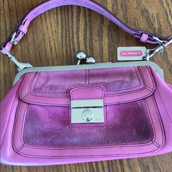Coach Handbags - Coach authentic wear on front swead